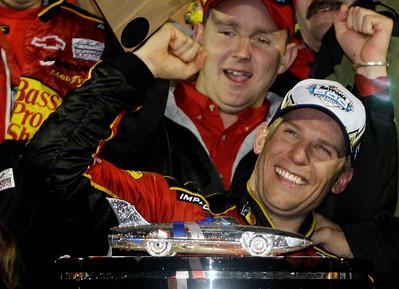 Jamie McMurray celebrates in Victory Lane after winning the Daytona 500 NASCAR auto race at Daytona International Speedway in Daytona Beach, Fla., Sunday, Feb. 14, 2010.(AP Photo/John Raoux)