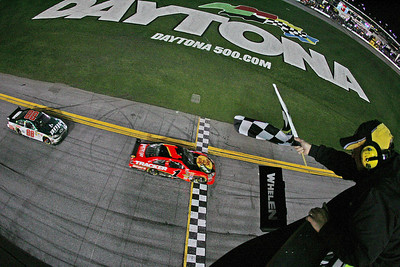 Jamie McMurray (1) followed by Dale Earnhardt Jr. (88) crosses the finish line to win the the NASCAR Daytona 500 auto race at Daytona International Speedway on Sunday, Feb. 14, 2010, in Daytona Beach, Fla.  (AP Photo/Todd Warshaw, Pool)