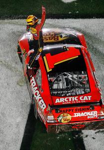 Jamie McMurray celebrates after winning the NASCAR Daytona 500 auto race at Dayton International Speedway in Daytona Beach, Fla., Sunday, Feb. 14, 2010. (AP Photo/Glenn Smith)