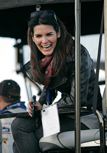 Actress Angie Harmon sits in the pit box for Jimmie Johnson's team during the NASCAR Daytona 500 auto race at Daytona International Speedway in Daytona Beach, Fla., Sunday, Feb. 14, 2010. (AP Photo/Reinhold Matay)