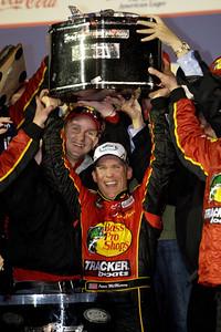 Jamie McMurray, center, celebrates in Victory Lane after winning the Daytona 500 NASCAR auto race at Daytona International Speedway in Daytona Beach, Fla., Sunday, Feb. 14, 2010. (AP Photo/John Raoux)