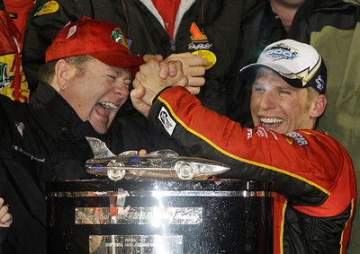 Team owner Chip Ganassi, left, and driver Jamie McMurray celebrate in Victory Lane after McMurray won the Daytona 500 NASCAR auto race at Daytona International Speedway in Daytona Beach, Fla., Sunday, Feb. 14, 2010. (AP Photo/John Raoux)