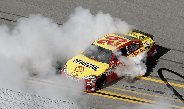 Kevin Harvick celebrates winning the NASCAR Sprint Cup Series Aaron's 499 auto race at Talladega Superspeedway in Talladega, Ala., Sunday, April 25, 2010. (AP Photo/Glenn Smith)