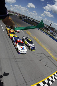 Jimmie Johnson, right, and Matt Kenseth (17) lead the field to the start of the NASCARR Sprint Cup Series Aaron's 499 auto race at Talladega Superspedway in Talladega, Ala., Sunday, April 25, 2010. (AP Photo/Todd Warshaw,Pool)