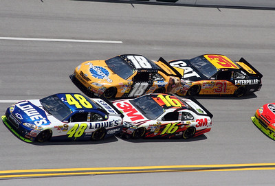 Jimmie Johnson (48), Matt Kenseth (17), Kyle Busch (18) and Jeff Burton (31) draft through turn four during the NASCAR Sprint Cup Series Aaron's 499 auto race at Talladega Superspeedway in Talladega, Ala., Sunday, April 25, 2010. (AP Photo/Dale Davis)