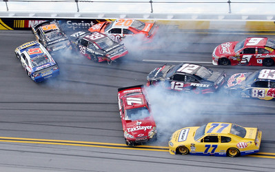 Marcos Ambrose (47), Elliott Sadler (19), Ryan Newman (39), Joey Logano (20), Bobby Labonte (71), Brad Kewselowski (12), Sam Hornish Jr. (77), Kasey Kahne (9) and Brian Vickers (83) crash during the NASCAR Sprint cup Series Aaron's 499 auto race at Talladega Superspeedway in Talladega, Ala., Sunday, April 25, 2010. (AP Photo/Dale Davis)