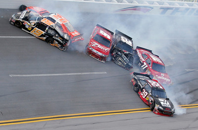 Elliott Sadler (19), Joey Logano (20), Kasey Kahne (9), Brad Keselowski (12), Bobby Labonte (71) and Ryan Newman (39) crash during the NASCAR Sprint Cup Series Aaron's 499 auto race at Talladega Superspeedway in Talladega, Ala., Sunday, April 25, 2010. (AP Photo/Russell Norris)