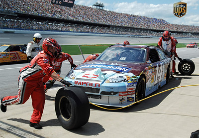 Crew members service Tony Stewart's car during the NASCAR Sprint Cup Series Aaron's 499 auto race at Talladega Superspeedway in Talladega, Ala., Sunday, April 25, 2010. (AP Photo/Rainier Ehrhardt)