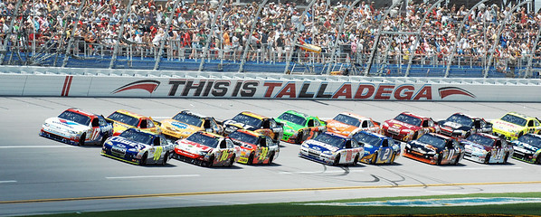 Pole sitter Jimmie Johnson (48), lower left, and Matt Kenseth (17) lead the field to the start of the NASCAR Sprint Cup Series Aaron's 499 auto race at Talladega Superspeedway in Talladega, Ala., Sunday, April 25, 2010. (AP Photo/Rainier Ehrhardt)