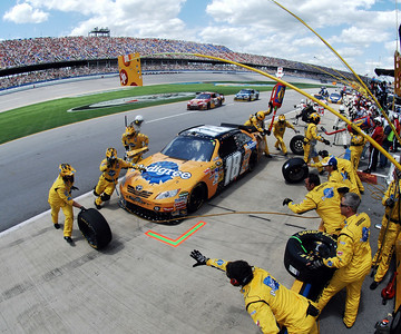Crew members work to refuel and change the tires on Kyle Busch's car during the NASCAR Sprint Cup Series Aaron's 499 auto race at Talladega Superspeedway in Talladega, Ala., Sunday, April 25, 2010. (AP Photo/Rainier Ehrhardt)