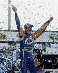 Kurt Busch reacts after winning the NASCAR Sprint Cup Series' Kobalt Tools 500 auto race at Atlanta Motor Speedway in Hampton, Ga., Sunday, March 7, 2010. (AP Photo/John Bazemore)