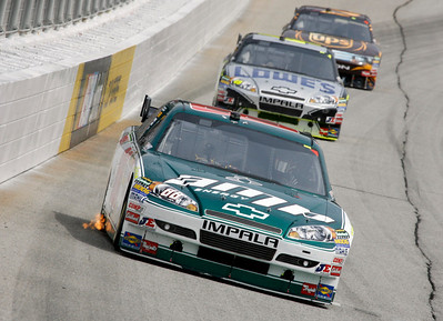 Dale Earnhardt Jr., leads Jimmie Johnson and David Ragan during the NASCAR Sprint Cup Series Kobalt Tools 500 auto  race at Atlanta Motor Speedway in Hampton, Ga., Sunday, March 7, 2010. (AP Photo/Glenn Smith)
