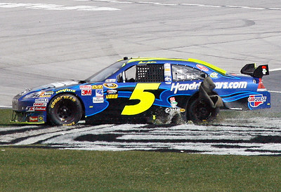 Mark Martin shreds a tire as he slides through the grass during the NASCAR Sprint Cup Series Kobalt Tools 500 auto race at Atlanta Motor Speedway in Hampton, Ga., Sunday, March 7, 2010. (AP Photo/Glenn Smith)