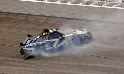 Robby Gordon slides across the track after hitting the wall during the NASCAR Sprint Cup Series  Kobalt Tools 500 auto  race at Atlanta Motor Speedway in Hampton, Ga., Sunday, March 7, 2010. (AP Photo/Glenn Smith)