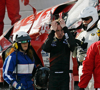 ** CORRECTS BYLINE ** Brad Keselowski, center, is helped to an ambulance after being involved in a crash during the NASCAR Sprint Cup Series' Kobalt Tools 500 auto race at Atlanta Motor Speedway in Hampton, Ga., Sunday, March 7, 2010. (AP Photo/Skip Williams)