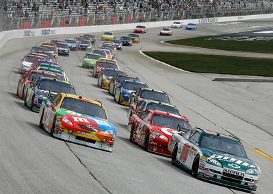 Dale Earnhardt Jr., right, and Kyle Busch lead the field to the green flag to start during the NASCAR Sprint Cup Series Kobalt Tools 500 auto race at Atlanta Motor Speedway in Hampton, Ga., Sunday, March 7, 2010. (AP Photo/Glenn Smith)