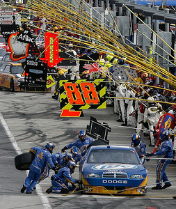 Crew members work to refuel and replace the tires on Kurt Busch's car during the NASCAR Sprint Cup Series Kobalt Tools 500 auto race at Atlanta Motor Speedway in Hampton, Ga., Sunday, March 7, 2010. (AP Photo/Glenn Smith)