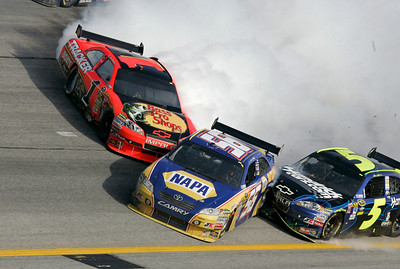 Martin Turex Jr. (55) crashes with Mark Martin (5) and Jamie McMurray (1) during the NASCAR Sprint Cup Series' Kobalt Tools 500 auto  race at Atlanta Motor Speedway in Hampton, Ga., Sunday, March 7, 2010. (AP Photo/Craig Hellmann)