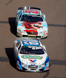 Carl Edwards (60) leads Denny Hamlin (20) down the front stretch during the NASCAR Nationwide Series Able Body Labor 200 auto race at Phoenix International Raceway in Avondale, Ariz., Saturday, Nov. 14, 2009. (AP Photo/Mary Schwalm)