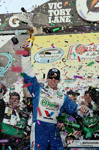 Driver Carl Edwards celebrates in victory lane after winning the NASCAR Nationwide Series Able Body Labor 200 auto race at Phoenix International Raceway in Avondale, Ariz., Saturday, Nov. 14, 2009. (AP Photo/Mary Schwalm)