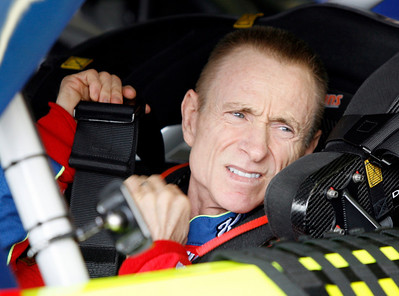 Driver Mark Martin straps himself into his car at the start of practice for Sunday's NASCAR Sprint Cup Checker O'Reilly Auto Parts 500 auto race at Phoenix International Raceway in Avondale, Ariz.,Saturday, Nov. 14, 2009. (AP Photo/Mary Schwalm)