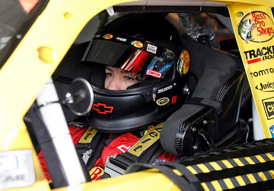 Pole sitter Martin Truex Jr., waits in his car after a brief rain delay for practice for Sunday's NASCAR Sprint Cup Checker O'Reilly Auto Parts 500 auto race at Phoenix International Raceway in Avondale, Ariz.,Saturday, Nov. 14, 2009. (AP Photo/Mary Schwalm)