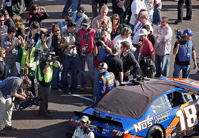 The media surrounds Kyle Busch prior to the start of the NASCAR Nationwide Series Able Body Labor 200 auto race at Phoenix International Raceway in Avondale, Ariz., Saturday, Nov. 14, 2009.  Busch was unable to clinch the championship after placing ninth. (AP Photo/Mary Schwalm)