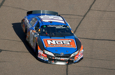 Damage is seen to the front right of Kyle Busch's car after a spinout during the NASCAR Nationwide Series Able Body Labor 200 auto race at Phoenix International Raceway in Avondale, Ariz., Saturday, Nov. 14, 2009. (AP Photo/Mary Schwalm)