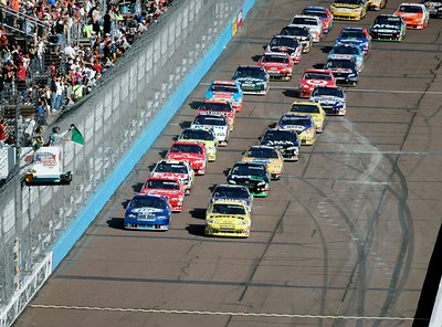 Pole-sitter Martin Truex Jr., right, leads the cars to the green flag at the start of the NASCAR Sprint Cup Series' Checker O'Reilly Auto Parts 500 race at Phoenix International Raceway in Avondale, Ariz., Sunday, Nov. 15, 2009. (AP Photo/Jason Babyak)