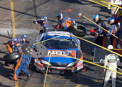 Kyle Busch makes an early pit stop after a spinout during the NASCAR Nationwide Series Able Body Labor 200 auto race at Phoenix International Raceway in Avondale, Ariz., Saturday, Nov. 14, 2009. (AP Photo/Mary Schwalm)