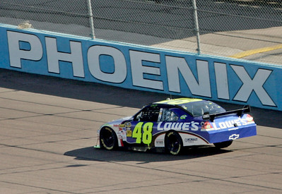 Jimmie Johnson heads into a corner during the NASCAR Sprint Cup Series' Checker O'Reilly Auto Parts 500 auto race at Phoenix International Raceway in Avondale, Ariz., Sunday, Nov. 15, 2009. (AP Photo/Jason Babyak)