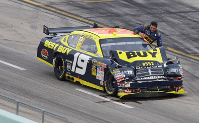Elliott Sadler gets out of his car after it caught on fire on pit road during the NASCAR Sprint Cup series auto race at Homestead-Miami Speedway in Homestead, Fla., Sunday, Nov. 22, 2009. (AP Photo/Lynne Sladky)