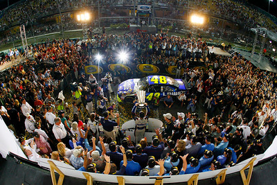 Jimmie Johnson holds up his trophy after winning the NASCAR Sprint Cup Series season championship, at Homestead-Miami Speedway in Homestead, Fla., Sunday Nov. 22, 2009. (AP Photo/Rusty Jarrett, Pool)