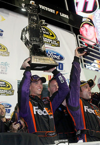 Denny Hamlin celebrates in victory lane after winning the NASCAR Ford 400 Sprint Cup Series auto race at Homestead-Miami Speedway in Homestead, Fla., Sunday, Nov. 22, 2009. (AP Photo/Wilfredo Lee)