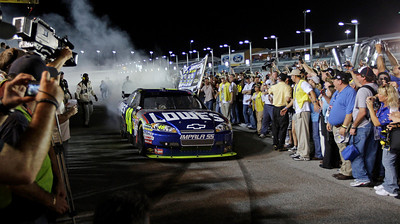 Jimmie Johnson performs a burnout as he heads to victory lane after winning the NASCAR Sprint Cup series championship at Homestead-Miami Speedway in Homestead, Fla., Sunday, Nov. 22, 2009. (AP Photo/Chuck Burton)