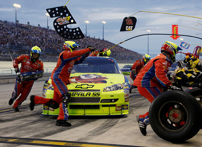 Mark Martin makes a pit stop during the NASCAR Sprint Cup Series' Ford 400 auto race at Homestead-Miami Speedway in Homestead, Fla., Sunday, Nov. 22, 2009. (AP Photo/Terry Renna)