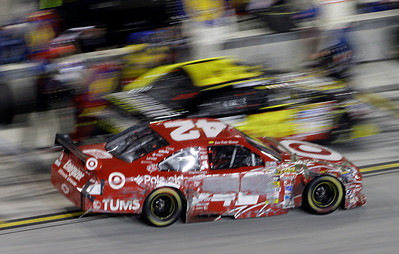 Juan Pablo Montoya (42) of Colombia drives away from a pit stop during the NASCAR Sprint Cup series auto race at Homestead-Miami Speedway in Homestead, Fla., Sunday, Nov. 22, 2009. (AP Photo/Lynne Sladky)