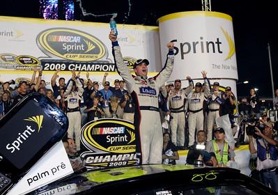 Jimmie Johnson celebrates after winning the NASCAR Sprint Cup Series season championship, at Homestead-Miami Speedway in Homestead, Fla., Sunday, Nov. 22, 2009. (AP Photo/Chuck Burton)