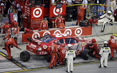 Juan Pablo Montoya, of Colombia, makes a pit stop during the NASCAR Sprint Cup series auto race at Homestead-Miami Speedway in Homestead, Fla., Sunday, Nov. 22, 2009. (AP Photo/Lynne Sladky)