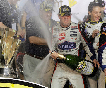 Jimmie Johnson celebrates after winning the NASCAR Sprint Cup Series season championship at Homestead-Miami Speedway in Homestead, Fla., Sunday, Nov. 22, 2009. (AP Photo/Terry Renna)