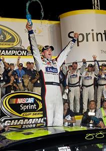 Jimmie Johnson celebrates after winning the NASCAR Sprint Cup season title at Homestead-Miami Speedway in Homestead, Fla., Sunday, Nov. 22, 2009. (AP Photo/Chuck Burton)