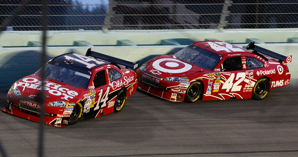 Juan Pablo Montoya (42), of Colombia, makes contact with Tony Stewart (14) during the NASCAR Ford 400 Sprint Cup Series auto race at Homestead-Miami Speedway in Homestead, Fla., Sunday, Nov. 22, 2009. (AP Photo/Wilfredo Lee)