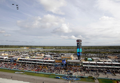 Aircraft fly over Homestead-Miami Speedway before the NASCAR Sprint Cup series auto race in Homestead, Fla., Sunday, Nov. 22, 2009. (AP Photo/Lynne Sladky)