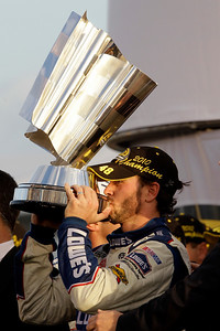 Jimmie Johnson kisses his  trophy after winning his fifth consecutive NASCAR Sprint Cup Championship in Homestead, Fla., Sunday, Nov. 21, 2010. (AP Photo/Lynne Sladky)
