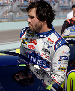 NASCAR driver Jimmie Johnson enters his car before the start of the Ford 400 auto race Sunday Nov. 21, 2010, in Homestead, Fla. (AP Photo/Lynne Sladky)