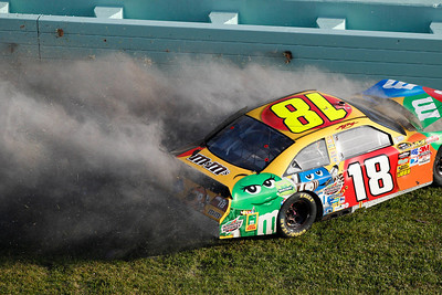 The No. 18 M&M's Toyota being driven by Kyle Busch hits the wall during the Ford 400 auto race, Sunday, Nov. 21, 2010, at Homestead-Miami Speedway in Homestead, Fla. (AP Photo/Wilfredo Lee)