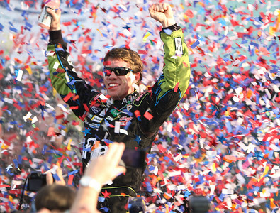 NASCAR driver Carl Edwards celebrates after winning the Ford 400 auto race Sunday, Nov. 21, 2010 in Homestead, Fla.(AP Photo/J Pat Carter)