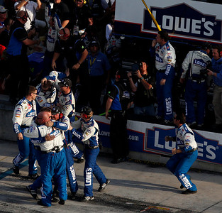 Crew members for NASCAR driver Jimmie Johnson celebrate after Johnson won the NASCAR Sprint Cup Series Championship, Sunday, Nov. 21, 2010, at Homestead-Miami Speedway in Homestead, Fla. (AP Photo/Wilfredo Lee)