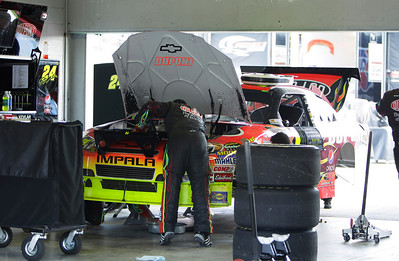 A member of NASCAR driver jeff Gordon's crew works on his car after the engine blew during the Ford 400 auto rac Sunday, Nov. 21, 2010 in Homestead, Fla.(AP Photo/J Pat Carter)