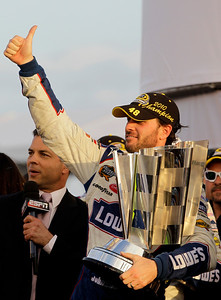 Jimmie Johnson waves after winning his fifth consecutive NASCAR Sprint Cup Championship in Homestead, Fla., Sunday, Nov. 21, 2010. (AP Photo/Lynne Sladky)
